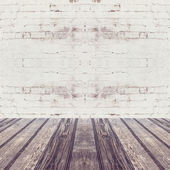 Wooden floor and brick wall — Stock Photo