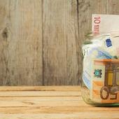 Money in glass jar — Stock Photo