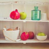 Fruits on kitchen shelf — Stock Photo