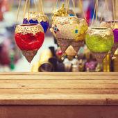 Arabic lanterns over table — Stock Photo