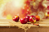 Apples on wooden table — Stock Photo