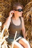 Sensual blonde sits on hay — Stock Photo