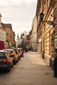 Paris, France - typical old city street. Cars parked along cobblestone way. — Stock Photo