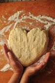 Dough in shape of heart — Stock Photo