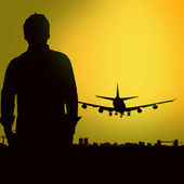 Man on the background of the landing airplane — Stock Photo