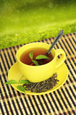 Cup with green tea — Stock Photo