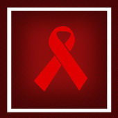 Aids awareness red ribbon — Stock Photo