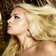 Beautiful blonde womin forest — Stock Photo #19361483