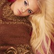 Blonde woman in poncho - Stock Photo