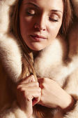 Beautiful lady in a fur — Stock Photo