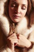 Beautiful lady in a fur — Stock Photo