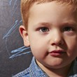 3 years old child near the blackboard — Stock Photo #22582335