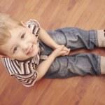 Fashion cute child on the floor — Stock Photo #24004651