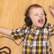 3 years old child listening music in headphones — Stock Photo #24004653