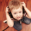 Small boy listening music in headphones — Stock Photo #24004655