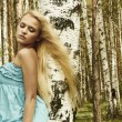 Beautiful blond woman in russian forest. flying hair — Stock Photo