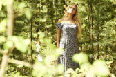 Beautiful blond woman walking in forest. summer — Stock Photo