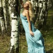 Beautiful blond woman in summer forest. flying dress — Stock Photo