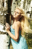 Beautiful blond woman in forest. summer — Stock Photo