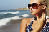 Beautiful blond woman on the beach — Stock Photo