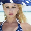 Stock Photo: Beautiful womwith blue shawl on beach