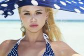 Beautiful woman with blue shawl on a beach — Stock Photo
