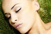Beautiful blond girl on green grass. beauty woman. sleep — Stock Photo