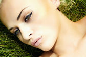 Beautiful blond girl on green grass. beauty woman. summer — Stock Photo