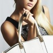 Fashionable beautiful blond woman with with handbag. shopping — Stock Photo