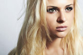Beautiful blond woman with disheveled hair.make-up — Stock Photo
