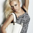 Fashionable beautiful blond woman with handbag. shopping — Stock Photo