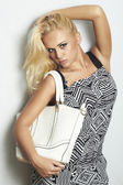 Fashionable beautiful blond woman with handbag.shopping — Stock Photo