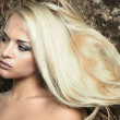 Stock Photo: Beautiful blond womin forest. hairs on tree