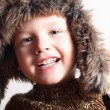 Funny smiling child in a fur hat. fashion kid. winter style. little boy. children — Stock Photo
