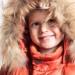 Smiling child in fur hood and orange winter jacket.fashion boy — Stock Photo