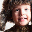 Stock Photo: Funny smiling child in fur hat.fashion.winter style.little boy