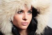 Beautiful woman with fur. white fur hood. winter style — Stock Photo
