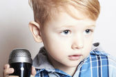 Little boy singing in microphone.child in karaoke.music — Stock Photo