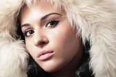 Young beautiful woman in fur hood. winter style. tender — Stock Photo