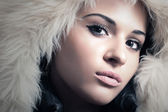 Fashion Portrait of Young Beautiful Woman in Fur Hood. Winter Style. Beauty Girl — Stock Photo