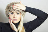 Beautiful Blond Woman in Fur Cap. Beauty Girl. Winter Style. Manicure — Zdjęcie stockowe