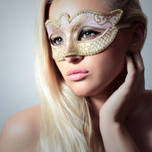 Beautiful Blond Woman in Carnival Mask.Masquerade. Sexy Girl — Stock Photo