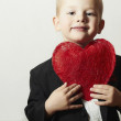 Smiling Child with Red Heart. Four Years Old Boy with Heart Symbol. Lovely Kid in Black Suit Valentine's Day — Stock Photo #38958477