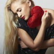 Lovely Beautiful Blond Woman with Red Heart. Beauty Girl. Show Love Symbol. Valentine's Day. Black Dress — Stock Photo #39084777