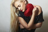 Lovely Beautiful Blond Woman with Red Heart. Beauty Girl. Show Love Symbol. Valentine's Day. Black Dress — Stock Photo