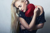 Beautiful Blond Woman with Red Heart. Beauty Girl. Show Love Symbol. Valentine's Day. Black Dress — Stock Photo