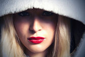 Woman with red lips in hood — Foto Stock