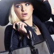 Stock Photo: Beautiful Blond Womin Black Hat. Fashionable Lady in Topcoat. Elegance Beauty Girl with Handbag. Spring Shopping