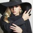 Stock Photo: Beautiful Blond Womin Black Hat. Fashionable Lady in Topcoat. Elegance Beauty Girl. Spring Collection