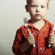 Little Handsome Boy with Fork and Knife. Hungry Child. Beauty and Food. Want to eat — Stock Photo #42542149